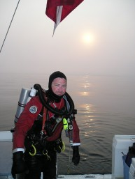 Mark Munro gets ready to  enter the water on a dive.